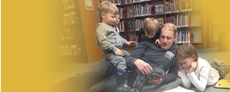A family reads together at the library