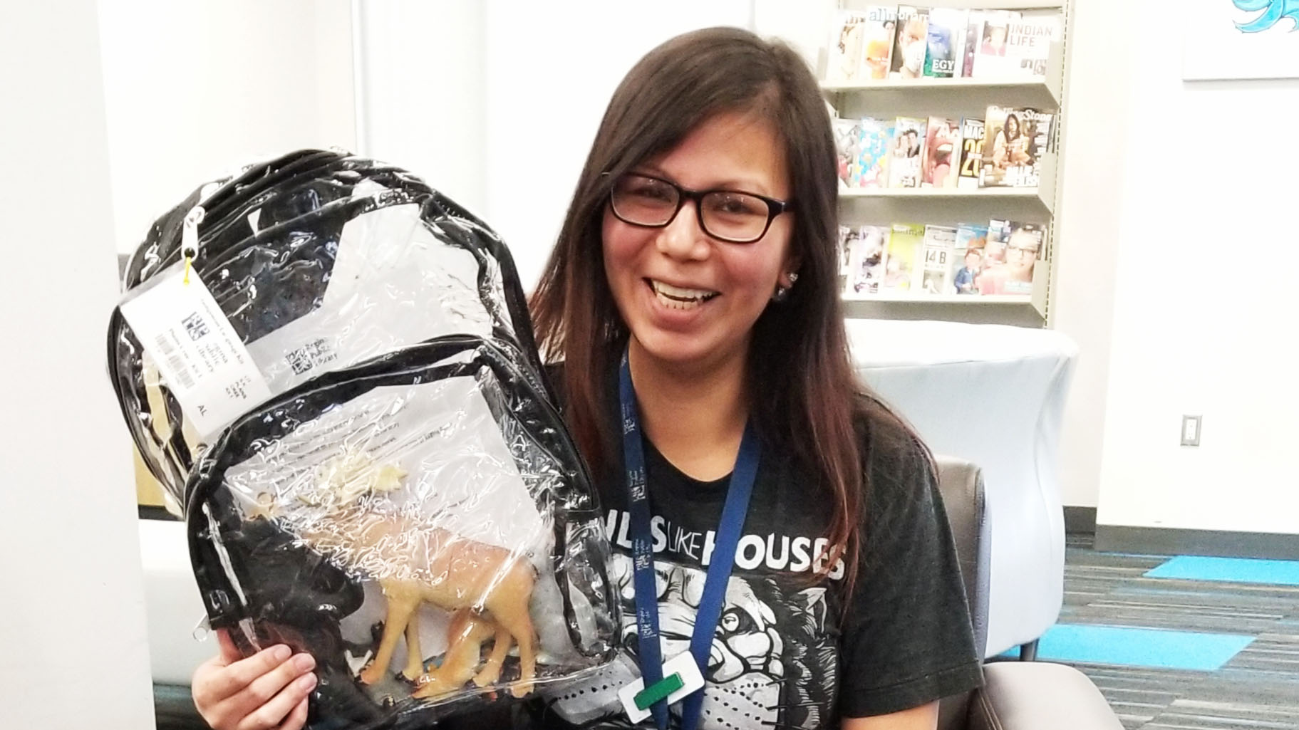 RPL staff member, Whitney, at mâmawêyatitân centre's Albert branch holding an Indigenous language kits
